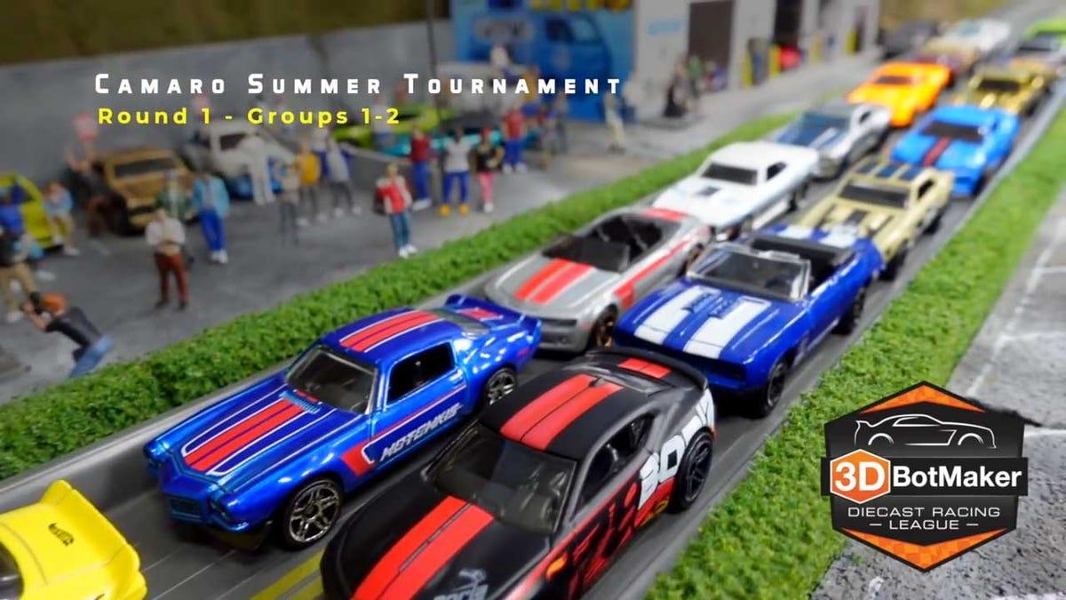 A closeup shot of diecast metal cars at the start of a miniature race.