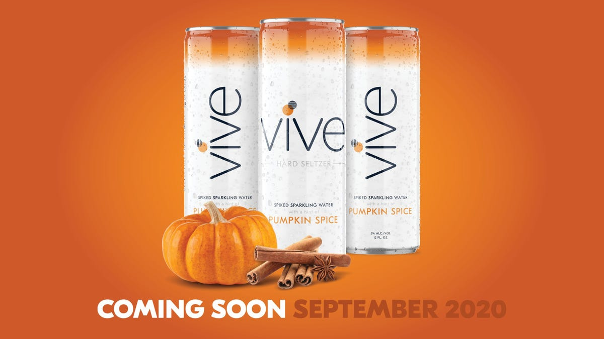 Vives new hard seltzer in pumpkin spice sits in front of an orange background with a mini pumpkin and cinnamon sticks.