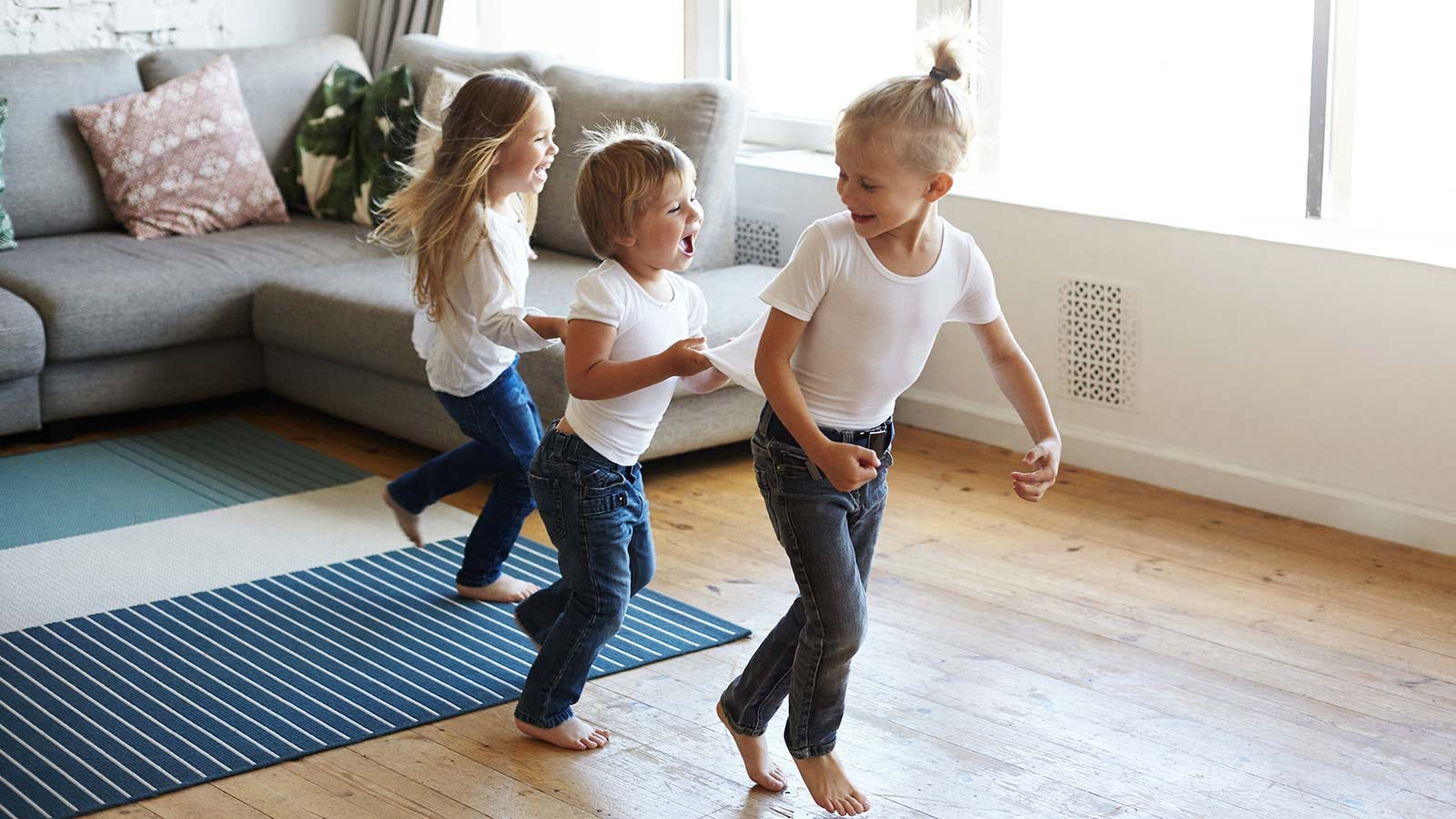 Three children playing freeze dance.