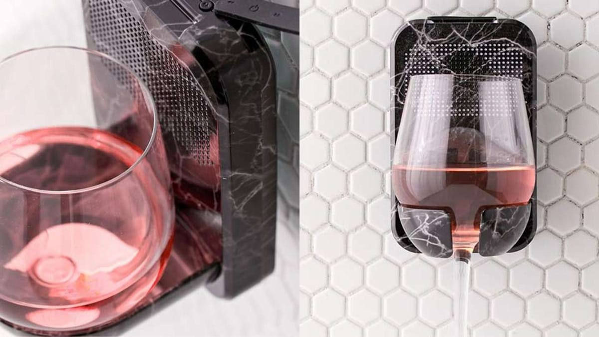 Product photos showing a wall mounted wine-glass-holding shower speaker.