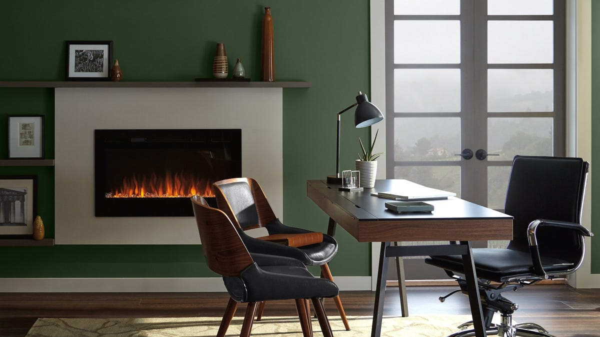Cozy office painted in a shade of green