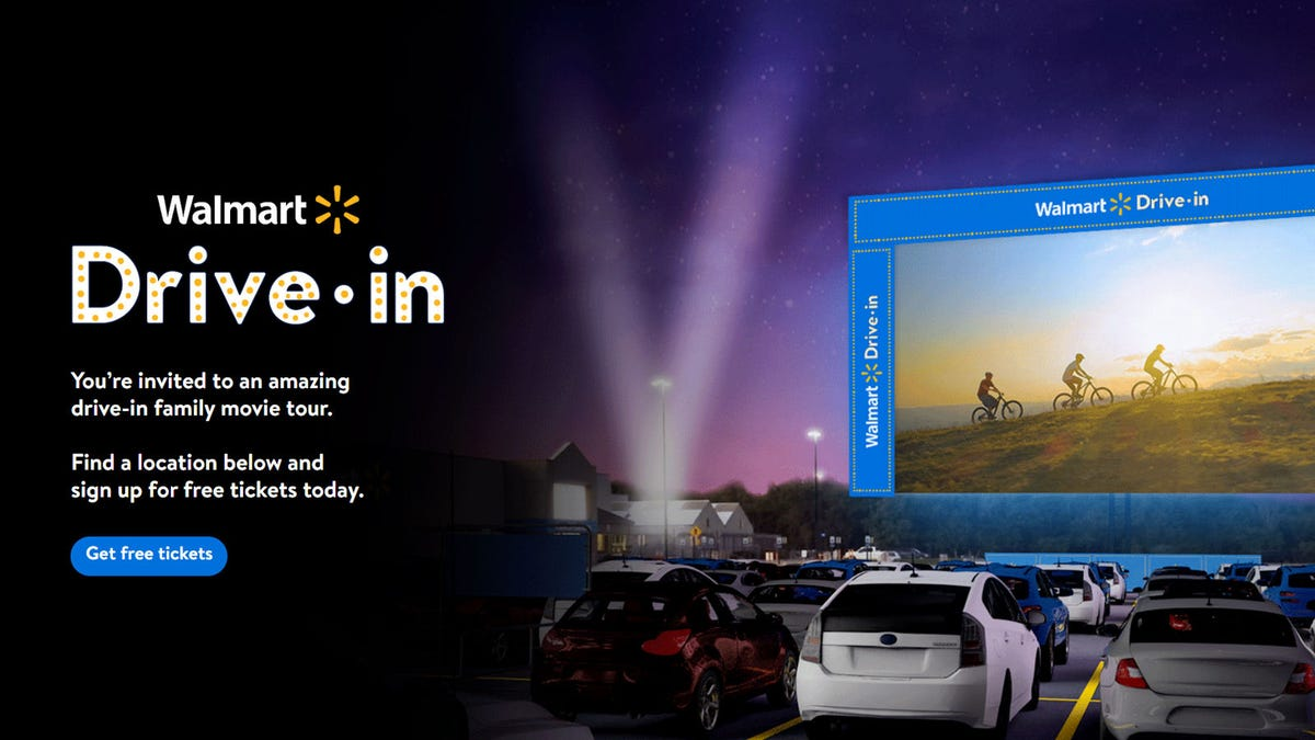 Cars parked in a Walmart parking lot, watching a film during one of Walmart's drive-in movie events.