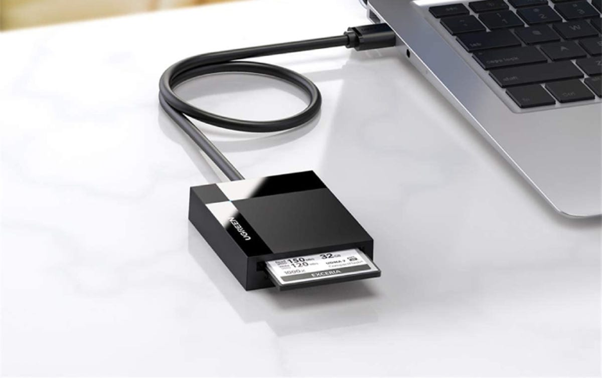 square black smart card reader plugged into a laptop