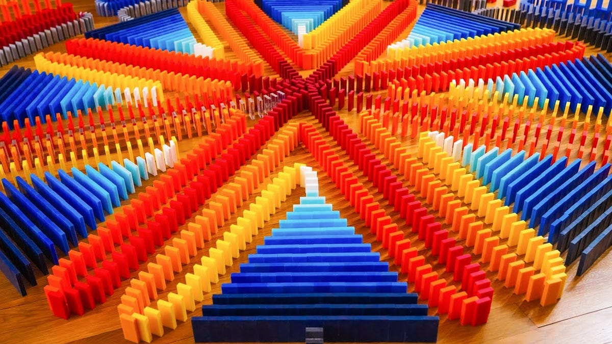 A closeup view of a complex domino spiral created by domino artist Lily Hevesh.