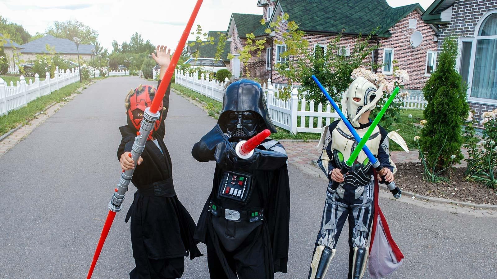 """Three kids in """"Star Wars"""" costumes."""