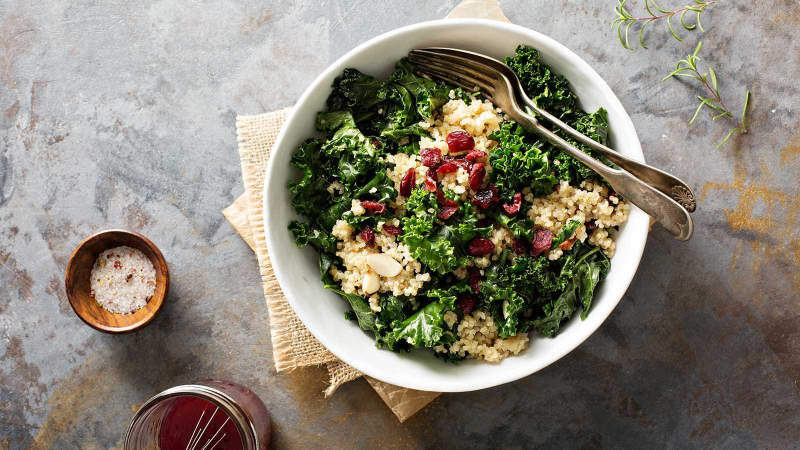 A hearty raw kale salad, loaded with quinoa grains.