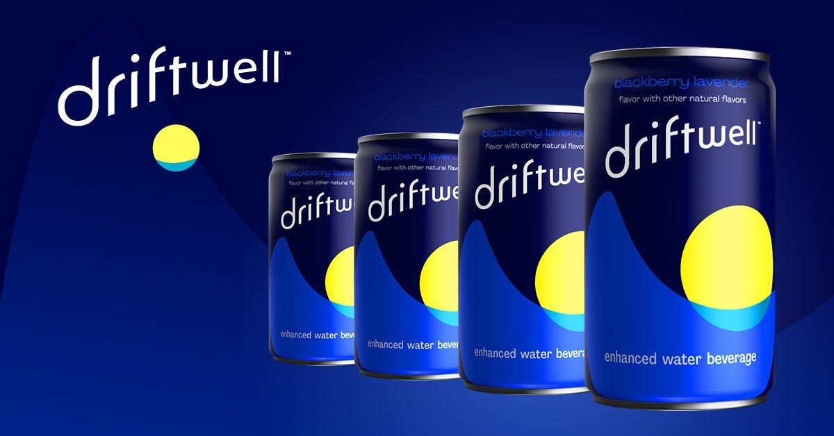 four navy blue cans lined up in a diagonal row sit in front of font that reads driftwell.