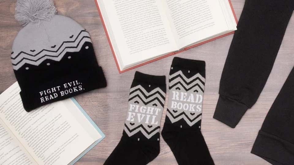 """A hat and socks with the slogan """"Fight Evil, Read Books"""" on them."""
