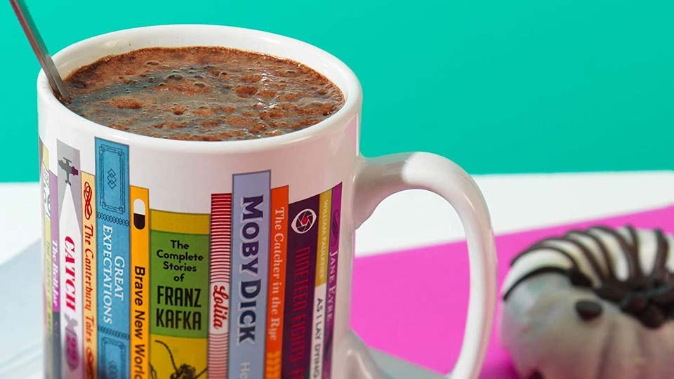 A mug with the spines of classic books.
