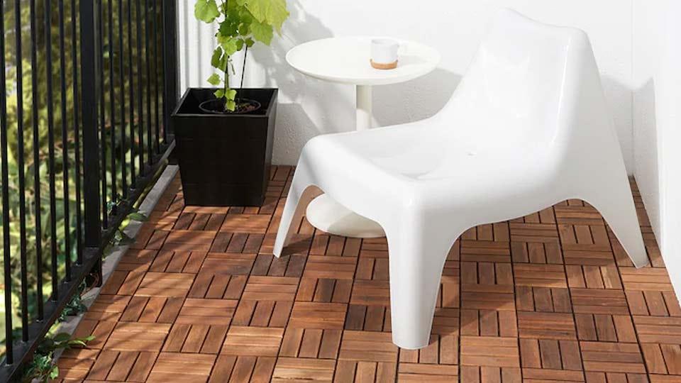 Wooden IKEA snap tiles on a balcony.