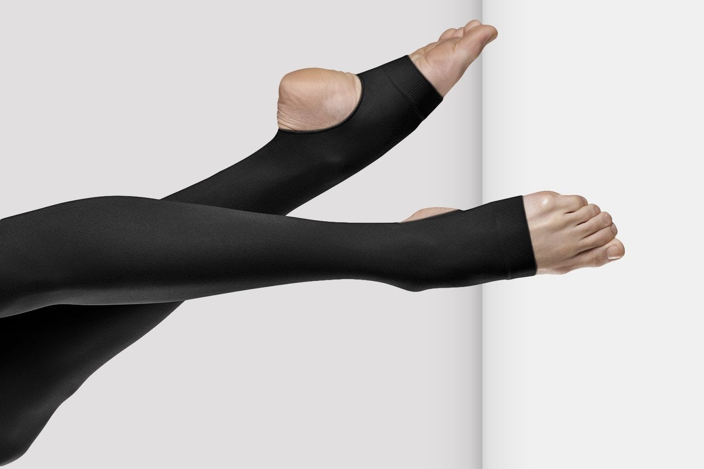Women's legs wearing black dancing tights.