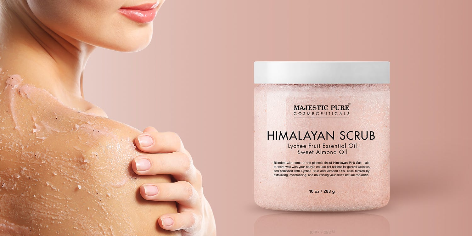 A woman rubbing some Majestic Pure Himalayan Scrub on her shoulder.