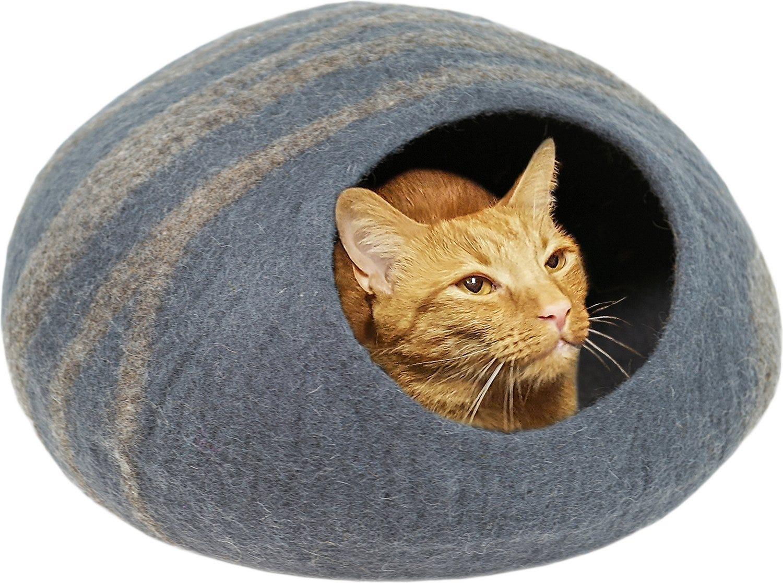 An orange cat in a gray felt cat cave.