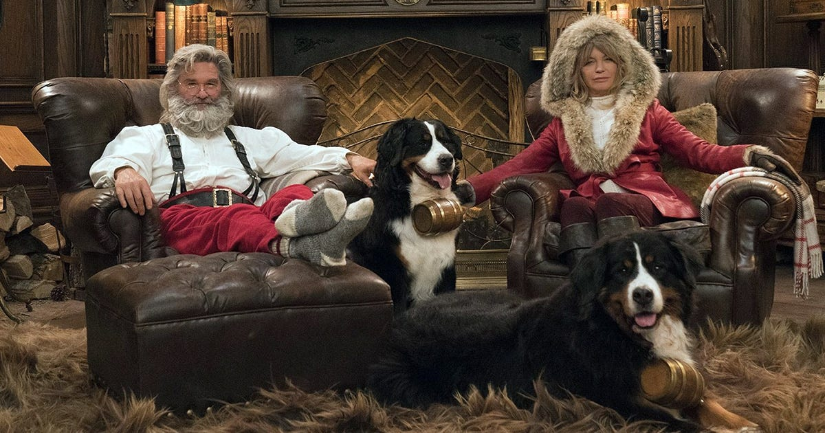 Kurt Russel and Goldie Hawn dressed up as Santa and Mrs. Claus.