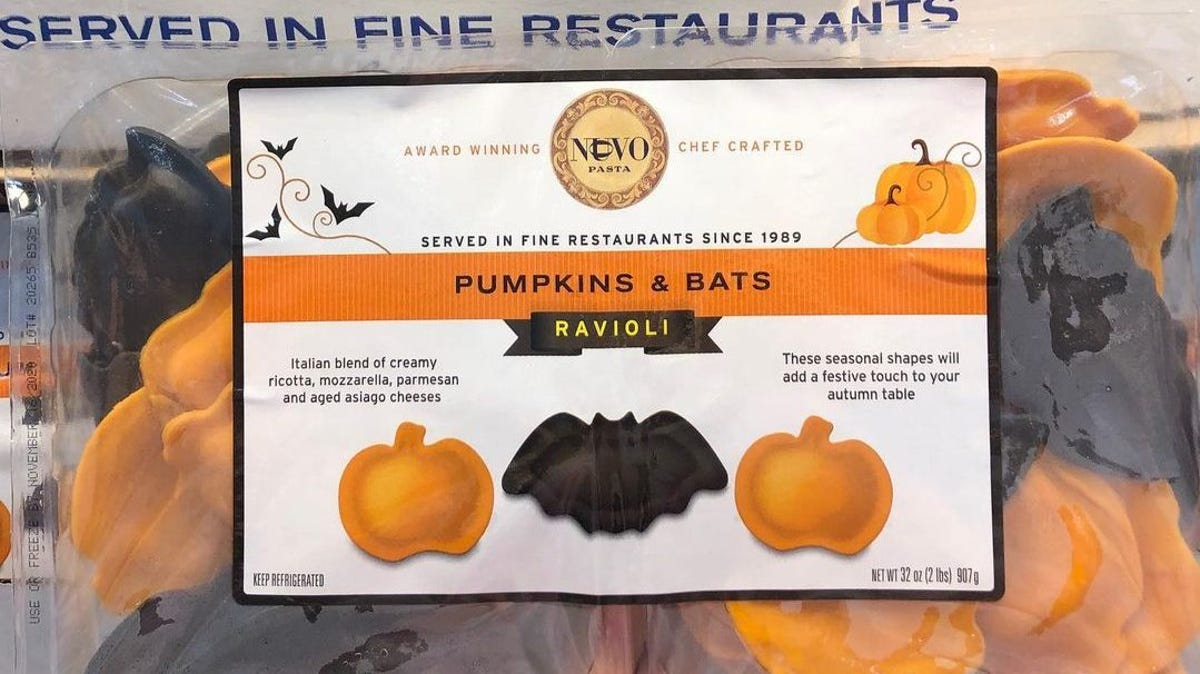 A bag of bat and pumpkin shaped pasta is held up for a better view.