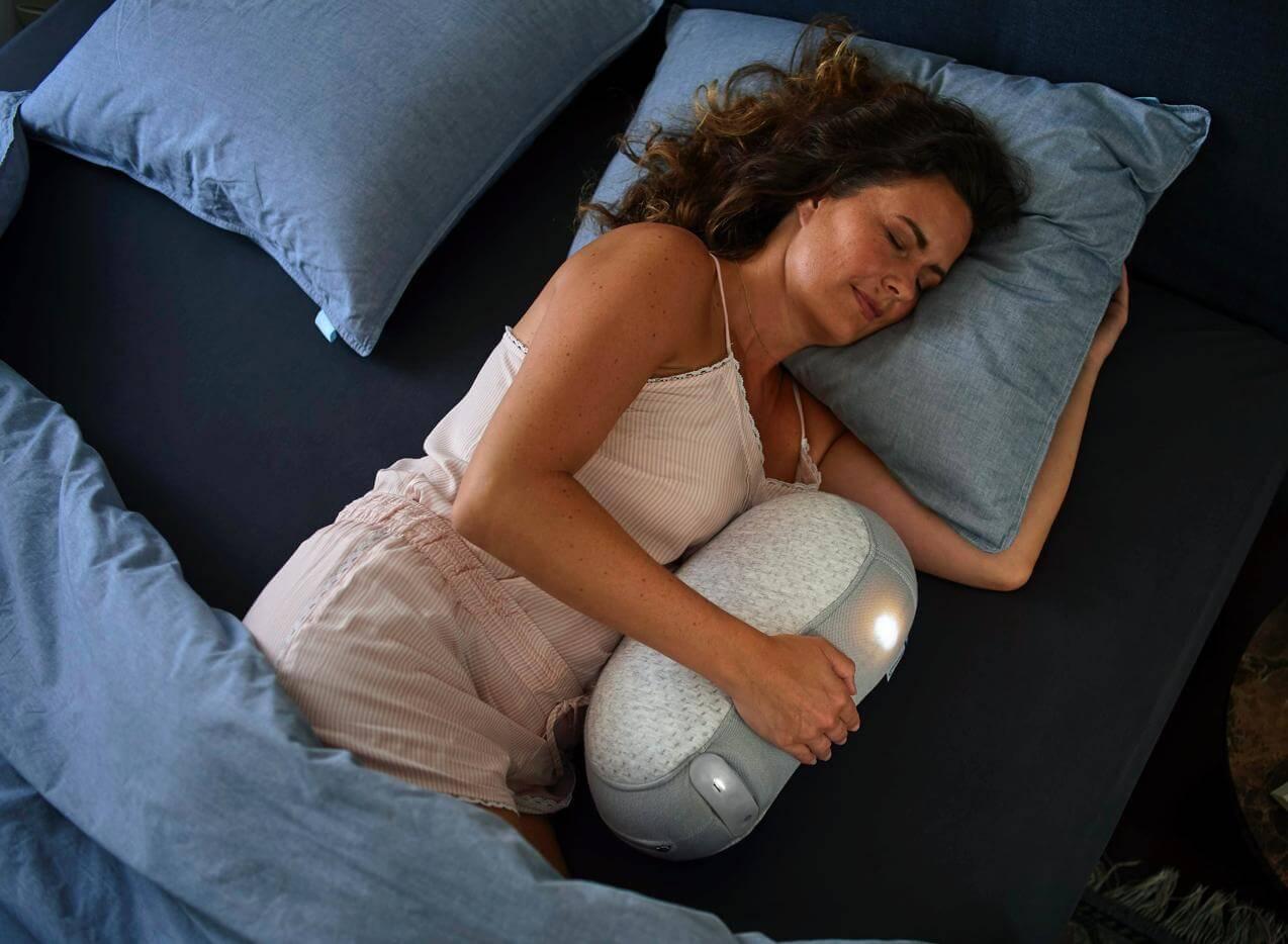 woman sleeping with Somnox Robot pillow