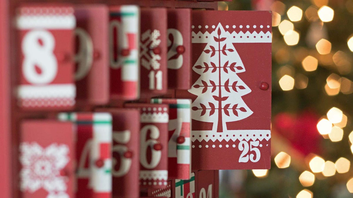 A wooden advent calendar with the focus on the 25th door, signaling the arrival of Christmas.