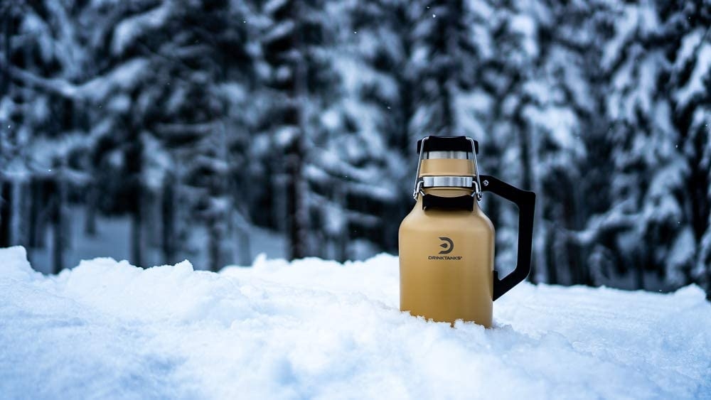 A DrinkTanks growler sitting in the snow.