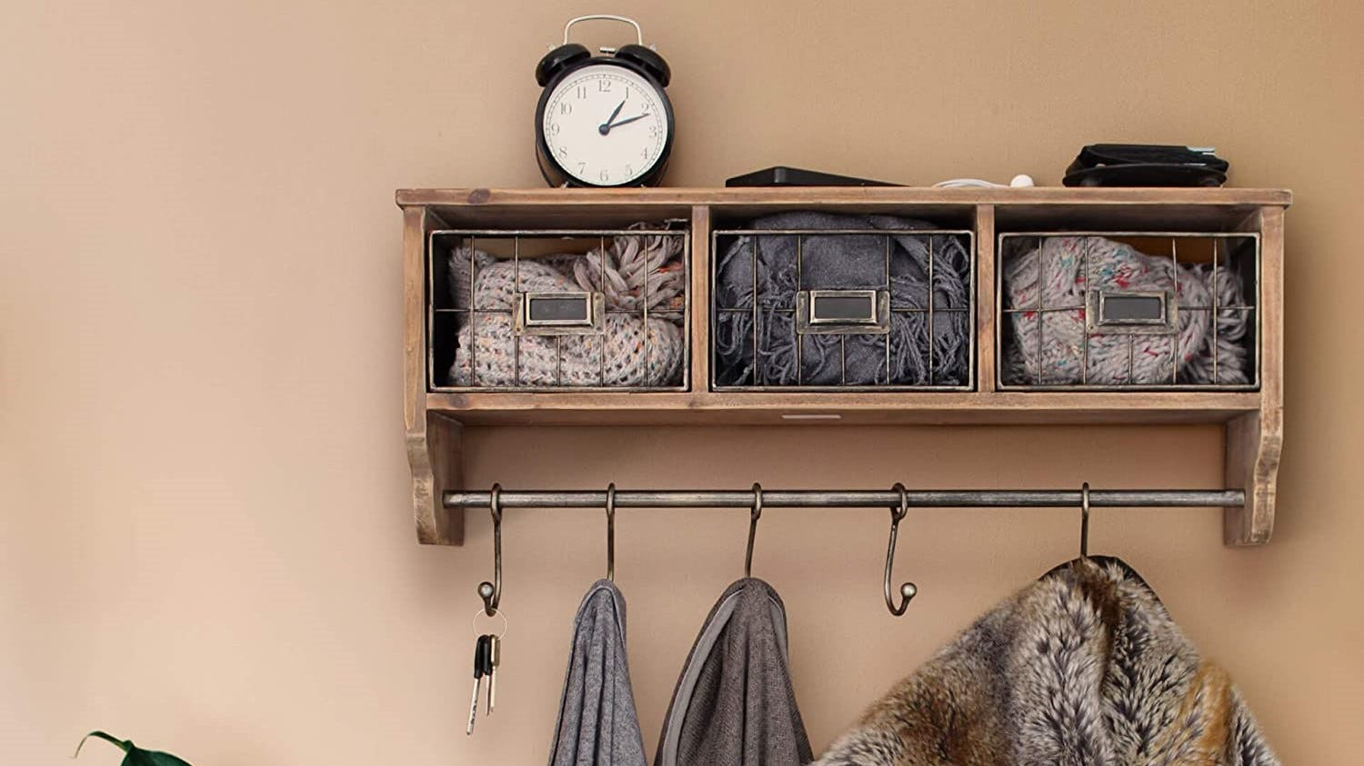 A wall-mounted coat rack with storage cubbies and hooks.