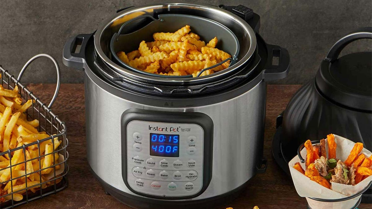 An Instant Pot Duo air fryer model filled with French fries, showing how the device can be used for fried goods.