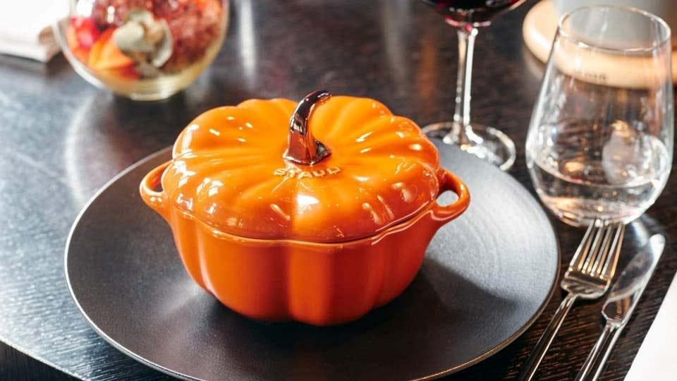 The Staub Ceramics Pumpkin Cocotte in orange.