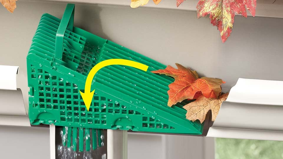 A green Wedge by Gutter Guard on a downspout.