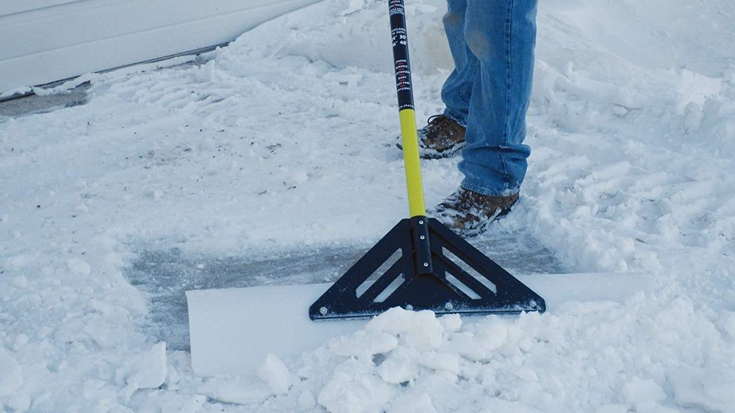 Snowplow shovel being used to clear snow.