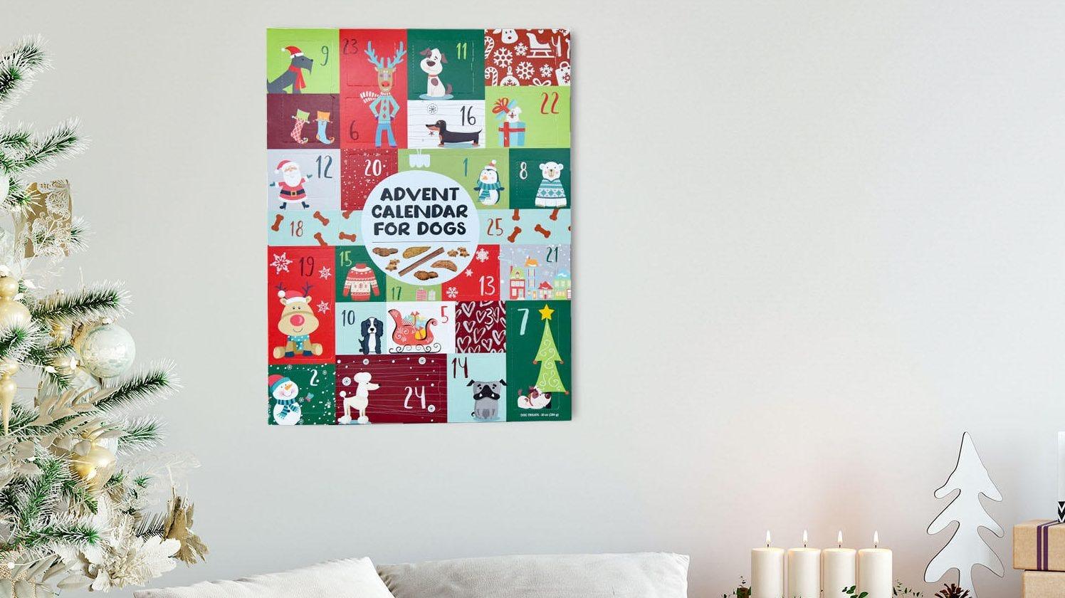 A dog adven calendar hangs above a couch.