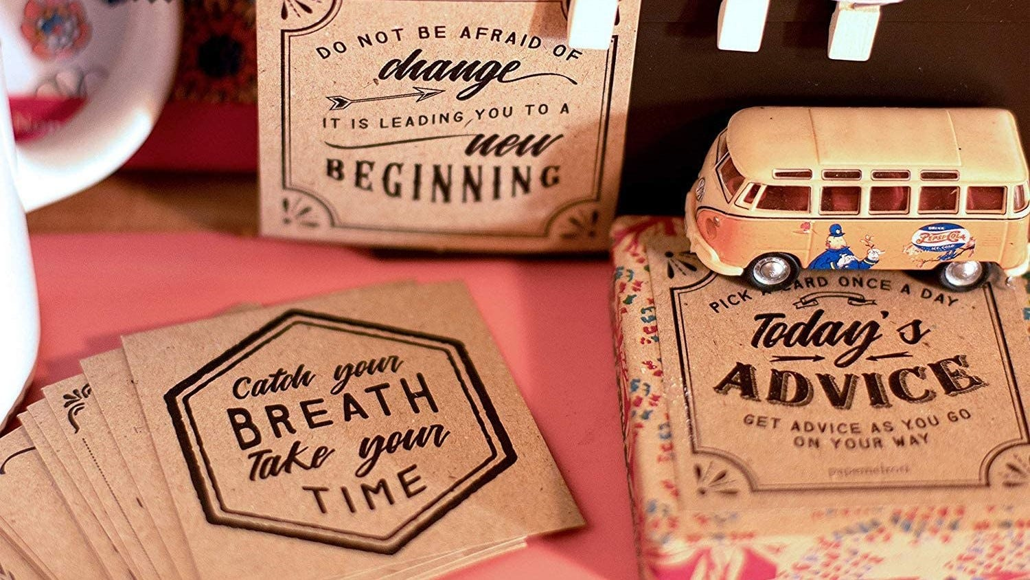 Motivational cards sitting on a table.