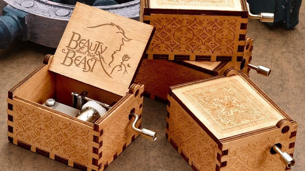 Beauty and the Beast music boxes with carved designs.