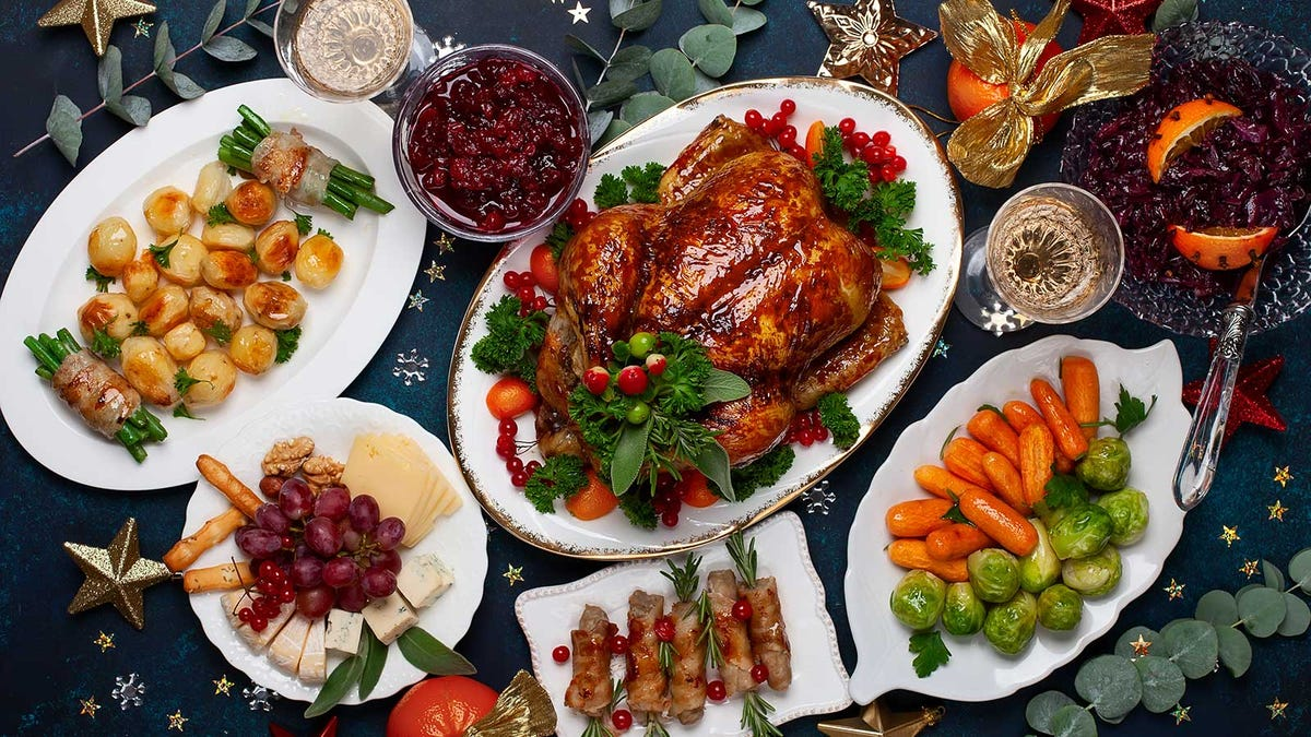 A table set with a variety of Christmas dinner sides.
