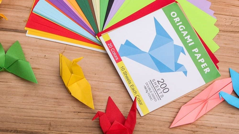 Solid origami paper paired with completed folds.