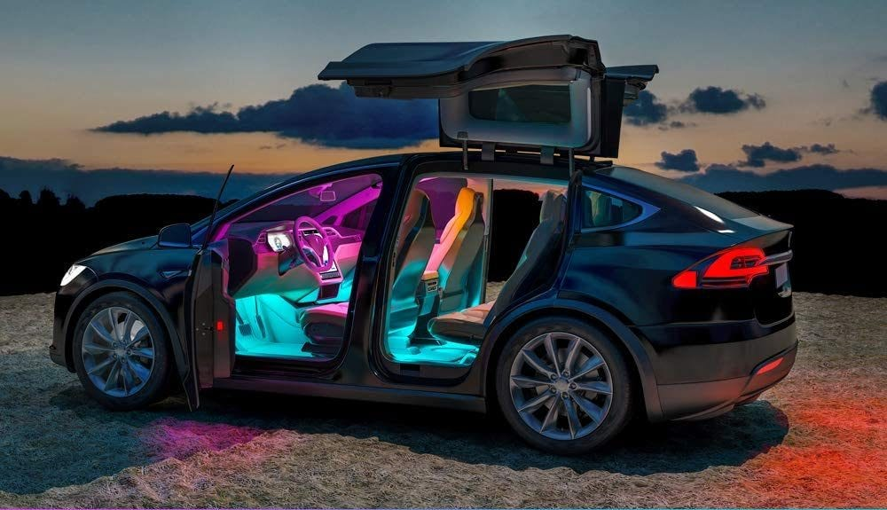 Car interior with colorful party LED lighting.