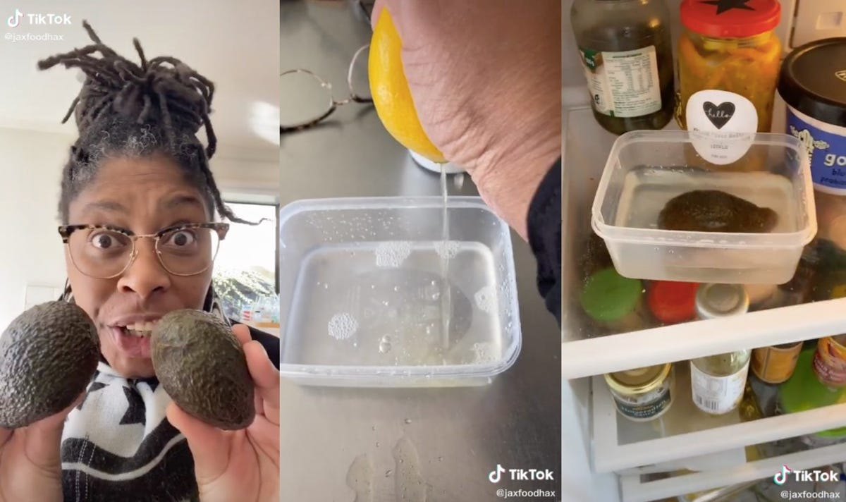 A woman displays an avocado before placing it in lemon water to preserve it.