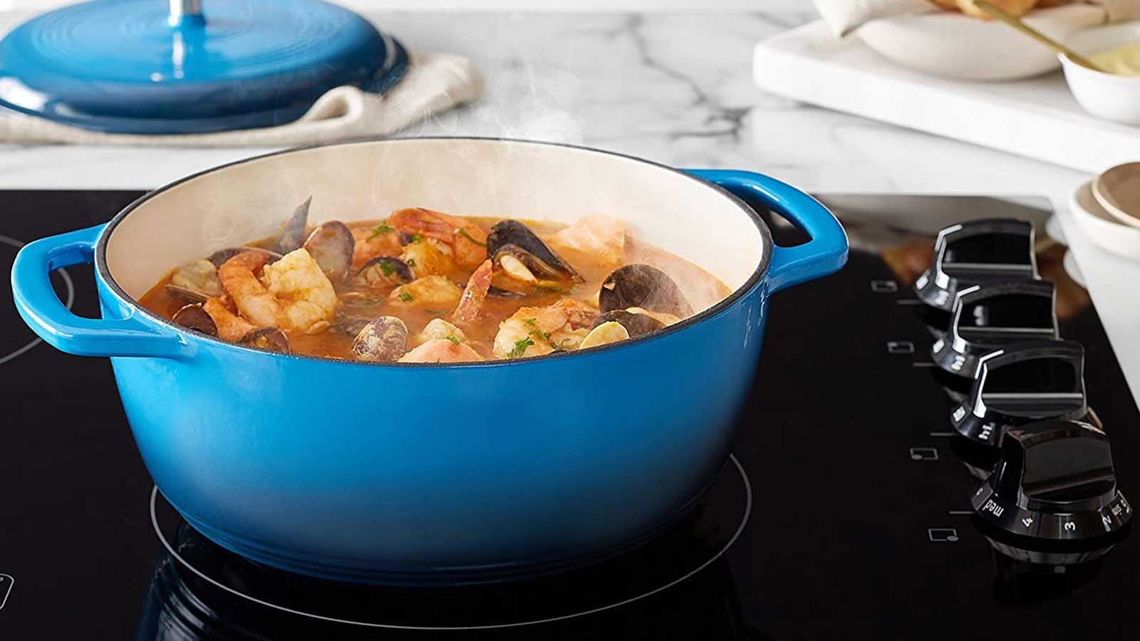 An AmazonBasics Dutch oven on an electric stovetop.