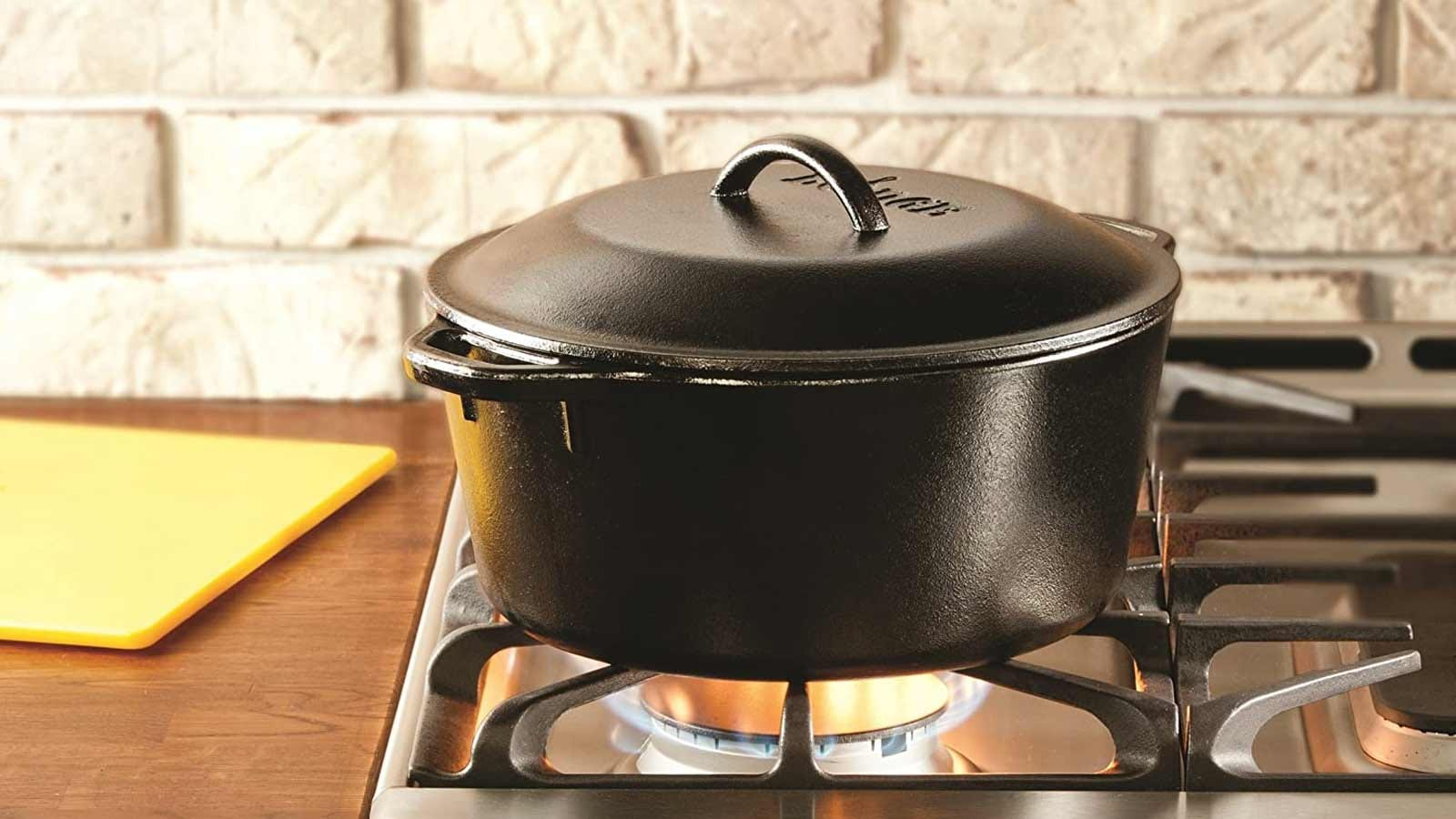 A Lodge cast-iron Dutch oven with a loop handle lid.