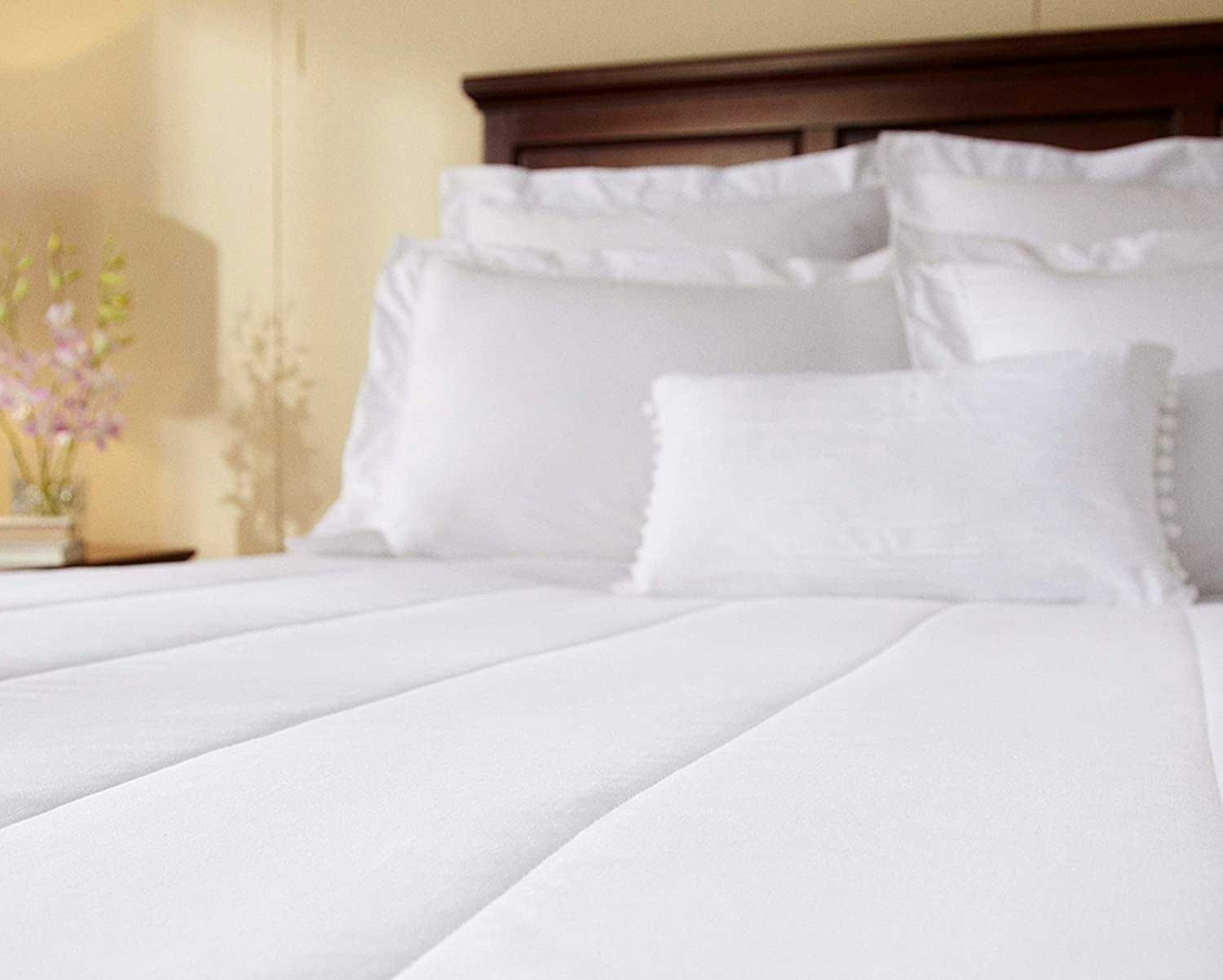 Sunbeam's best budget pick heated mattress pad, stretched over a queen size bed.