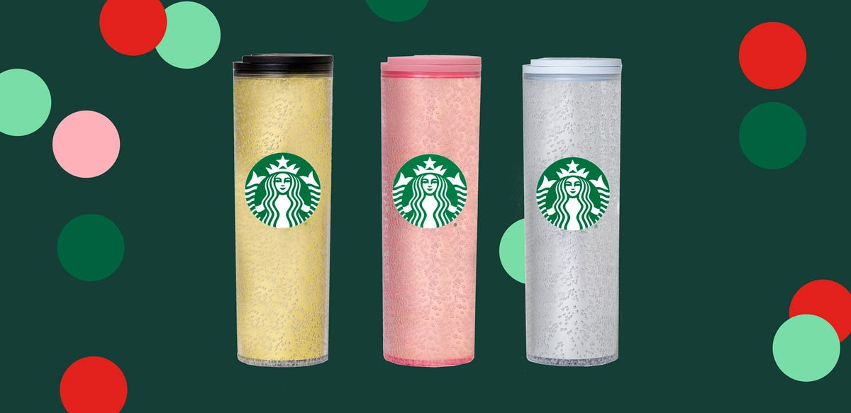 Starbucks' hot tumblrs sit lined up against a festive background.