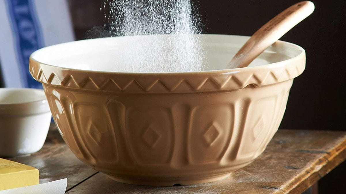 A patterned mixing bowl on a counter.