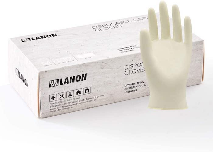 a white box of disposable gloves and one glove displayed outside of the box