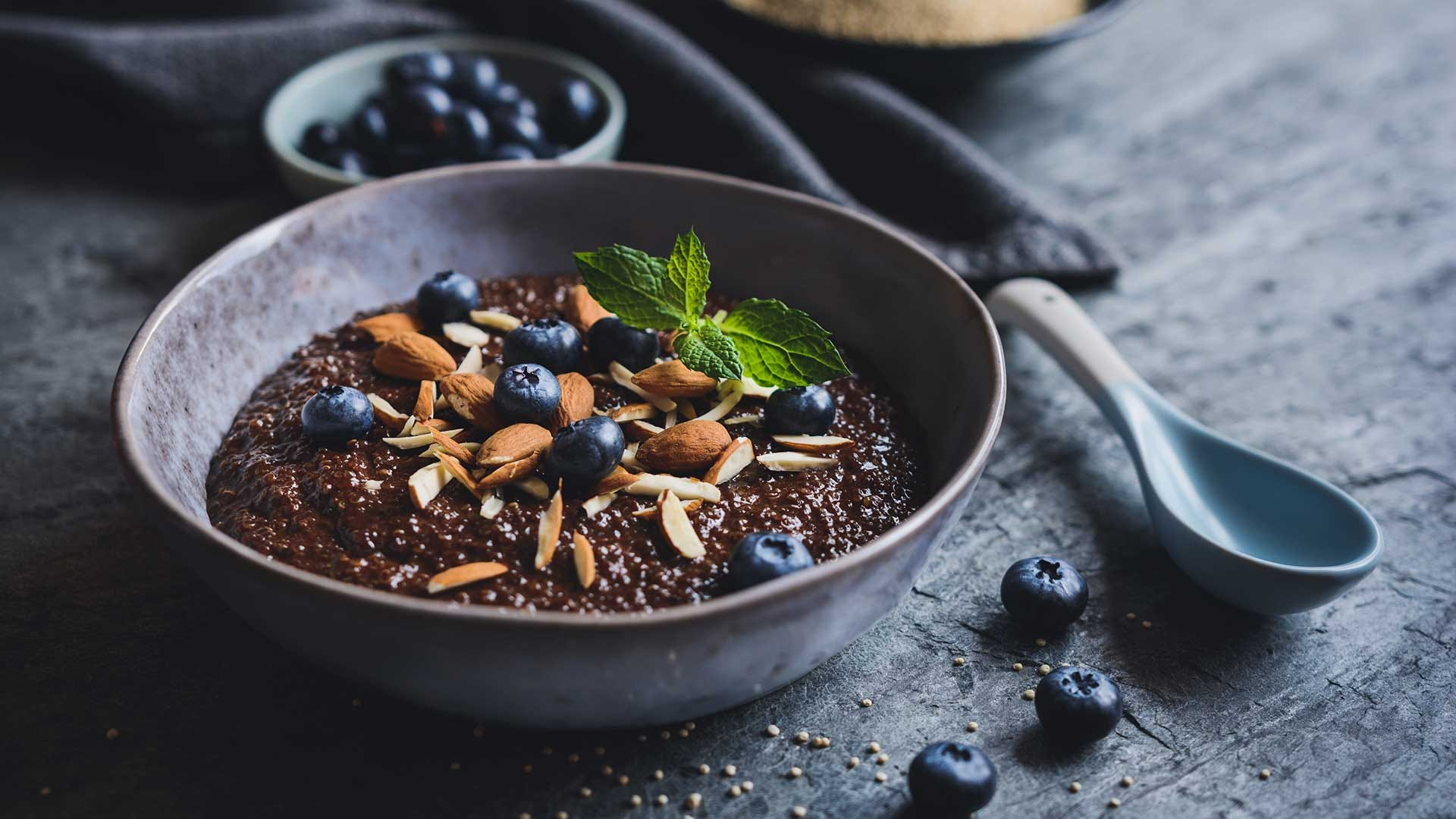 Healthy chocolate Quinoa porridge with coconut milk, honey, almonds and blueberry.