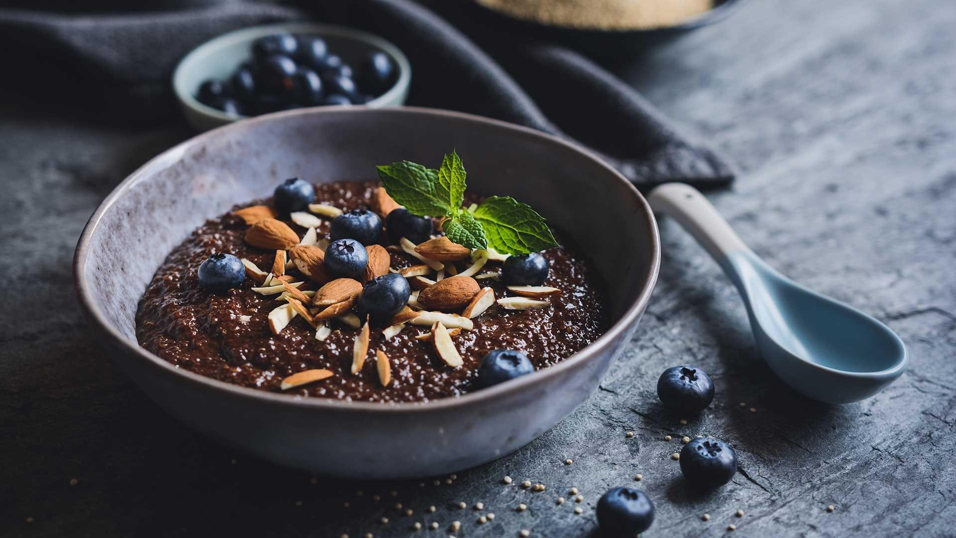 Healthy chocolate Quinoa porridge with coconut milk, honey, almonds and blueberry.