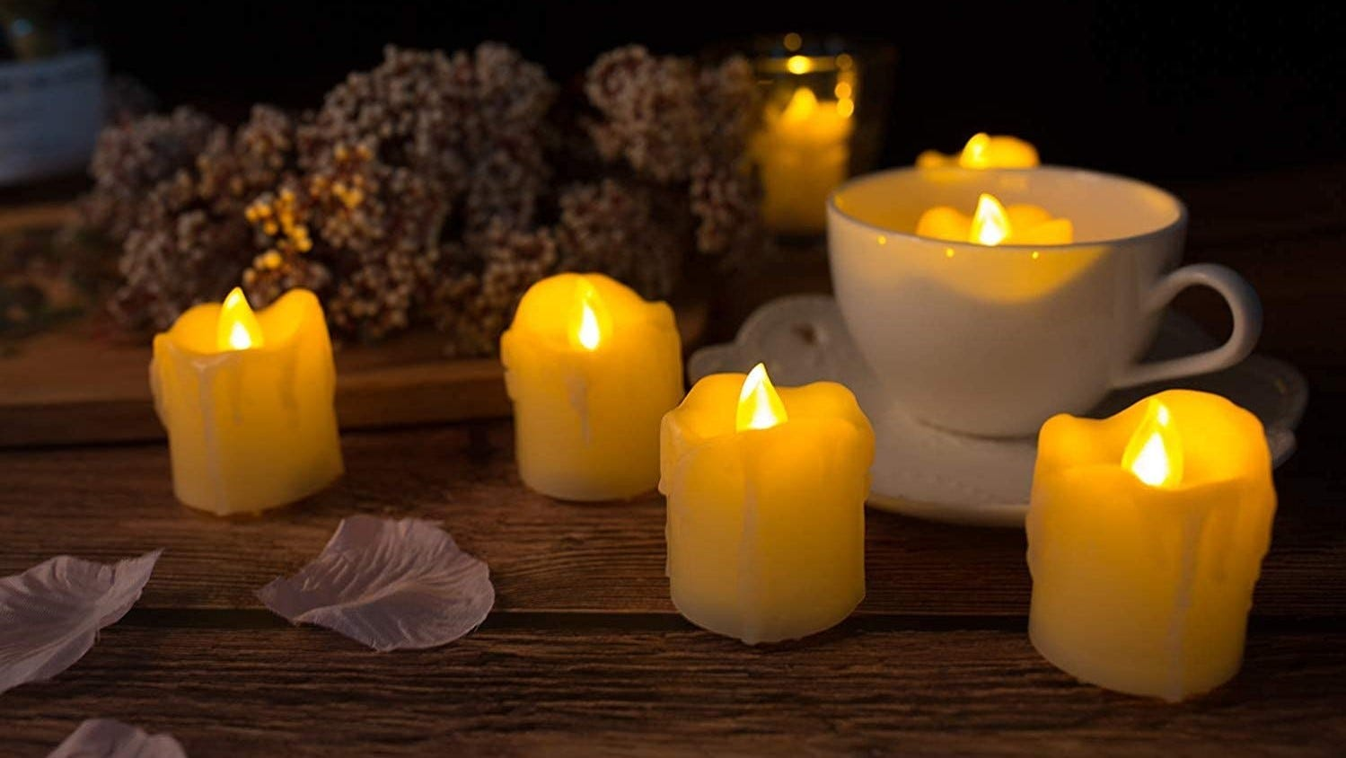 Flickering fake candles on a table.