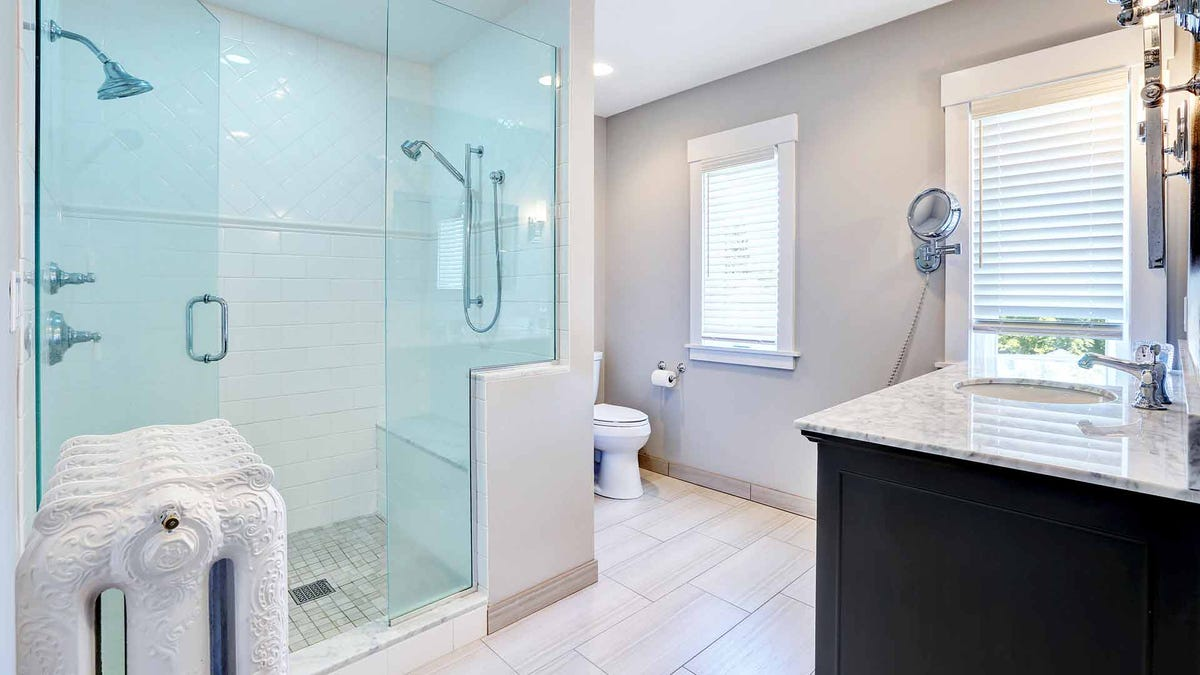 A remodeled bathroom with a walk-in shower.