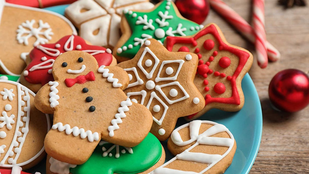 A plate filled with Christmas cookies.