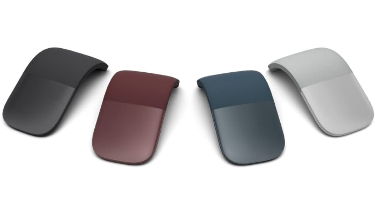 four different-colored, minimalistic arched mice for computers