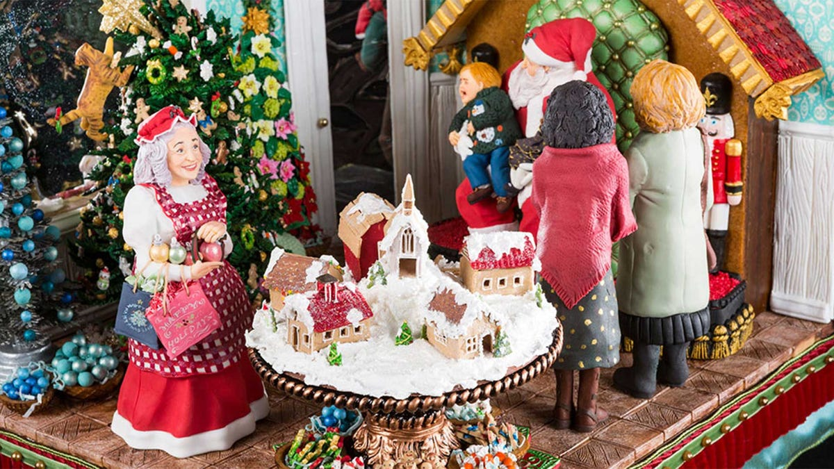 A closeup of a very detailed gingerbread house.