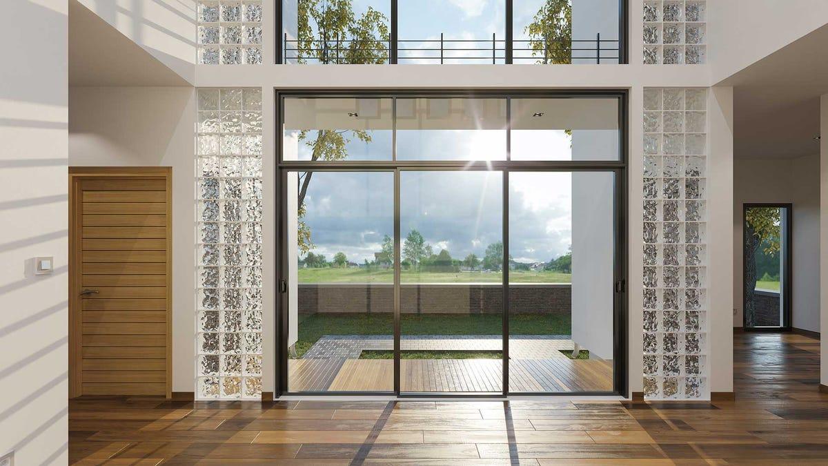An sliding glass door framed by glass block.