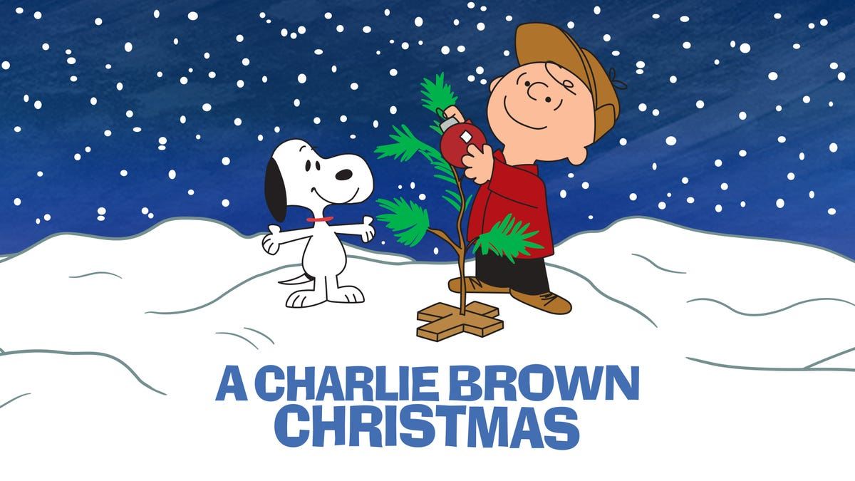 Charlie Brown and Snoopy decorate a sparse Christmas tree.