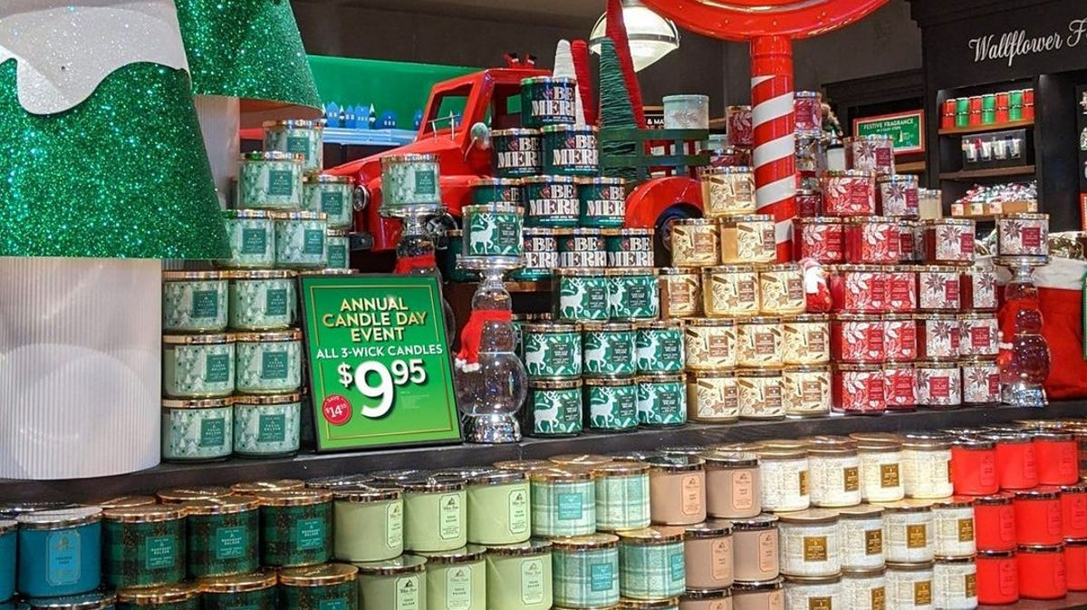 A store display in Bath & Body Works showcases all of the brand's candles.